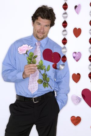 attractive man wearing formal blue shirt and black pants during valentines day Stock Photo