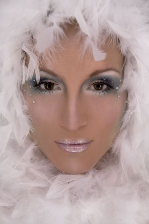 stunning blond model wearing white boa and dark makeup