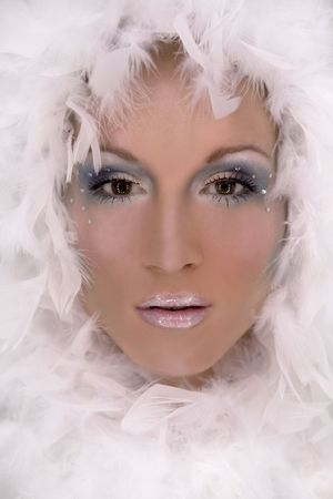 stunning blond model wearing white boa and dark makeup Stock Photo - 718039