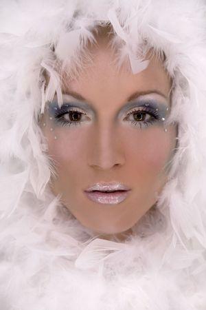 stunning blond model wearing white boa and dark makeup Stock Photo - 718039