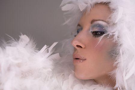 stunning blond model wearing white boa and dark makeup photo