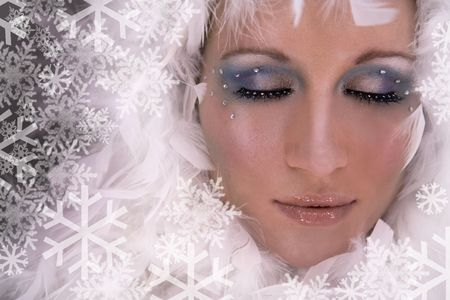 stunning blond model wearing white boa and dark makeup