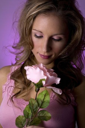 stunning blond model holding pink rose wearing pink tank top