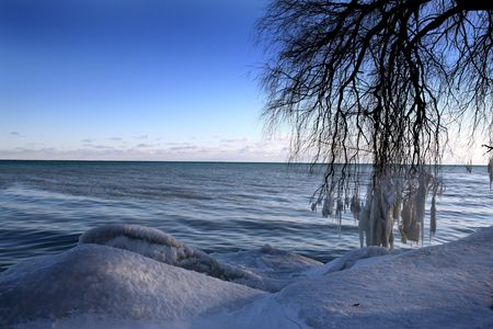beautiful winter nature scene, snow and ice around ocean, sun photo