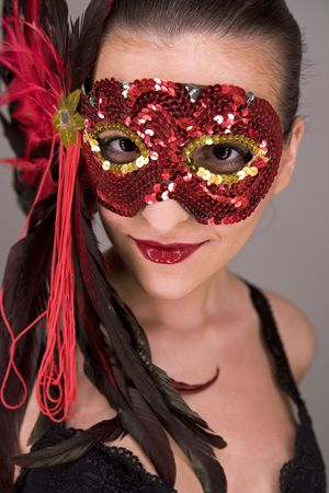 mysteus brunette wearing carnival red mask on her face Stock Photo - 769830