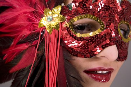 mysterious brunette wearing carnival red mask on her face Stock Photo - 769828