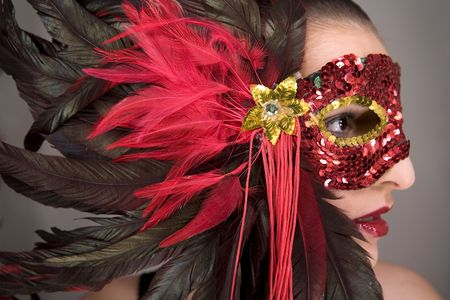 mysterious brunette wearing carnival red mask on her face Stock Photo - 769829