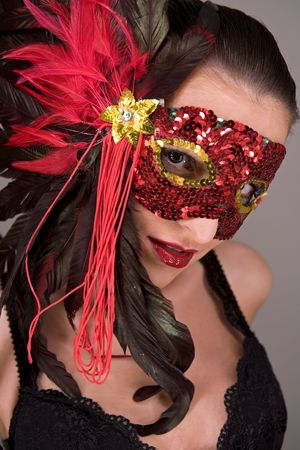 mysterious brunette wearing carnival red mask on her face Stock Photo - 769827
