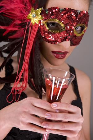 mysterious brunette wearing carnival red mask on her face Stock Photo - 769825