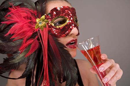 mysterious brunette wearing carnival red mask on her face Stock Photo - 769824
