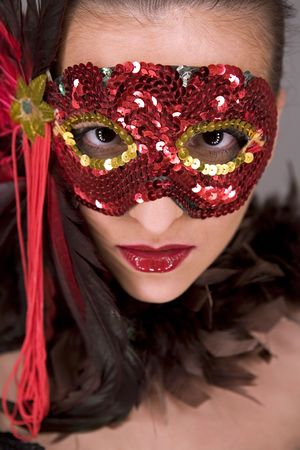mysteus brunette wearing carnival red mask on her face Stock Photo - 769823