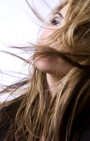 long: healthy beautiful long hair in motion created by wind, fashion look