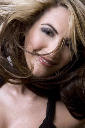 healthy beautiful long hair in motion created by wind, fashion look photo