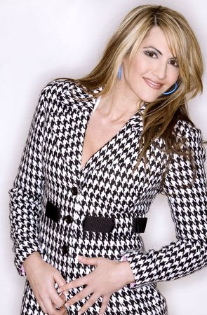 pretty woman wearing black and white jacket on white isolated background photo