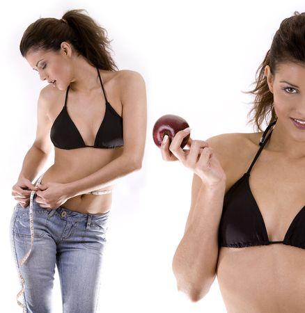 talle: mujer delgada atractiva joven hermosa que mide su cintura