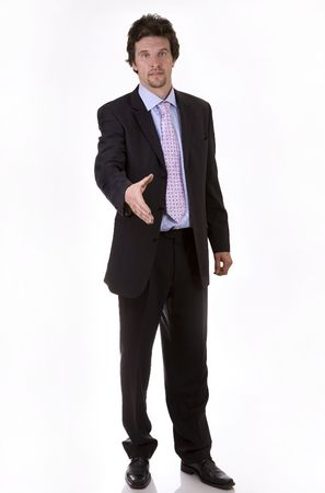 business man standing offering a hand on white isolated background Stock Photo - 950500