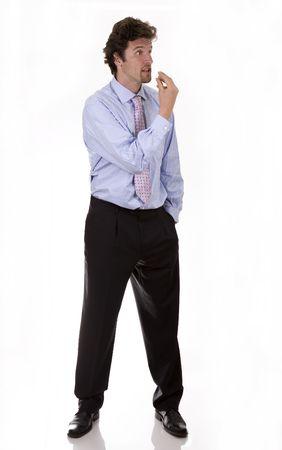 얼굴 표정: business man making facial expression on white isolated background