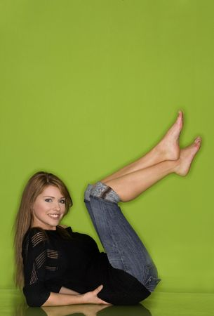 stunning young woman wearing black outfit on green background
