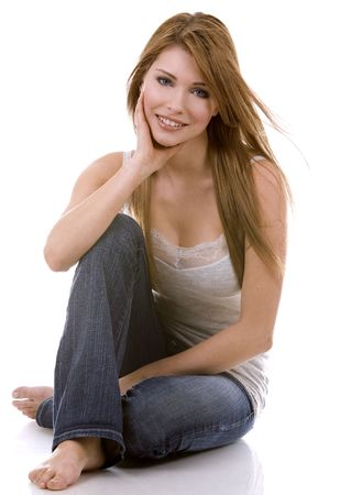 pretty casual woman wearing jeans and tank top on white background