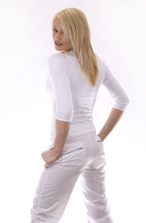 pretty russian woman wearing white outfit on white background Stock Photo