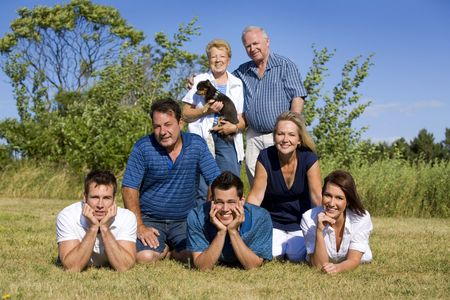family of seven with three generations in the summer Stock Photo