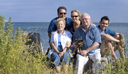 family of five with three generations in the summer Stock Photo