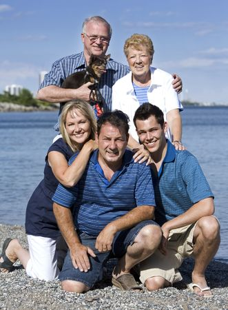 family of five with three generations in the summer photo