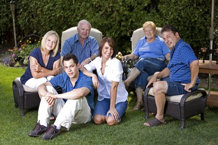 family of six with three generations in the summer photo
