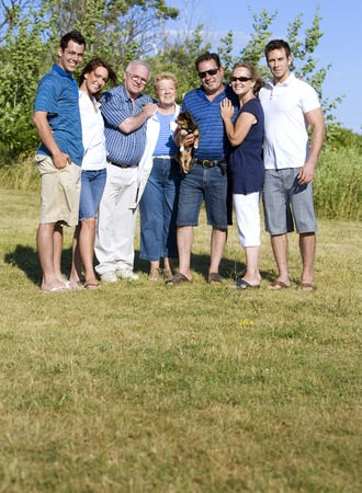 family of seven with three generations in the summer photo