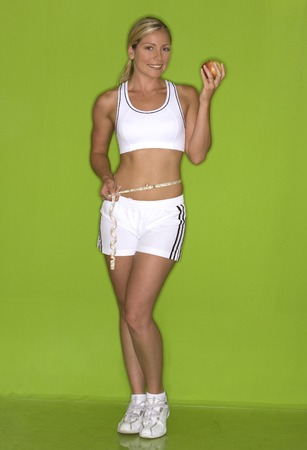 healthy fitness model posing on green isolated background Stock Photo - 1575945