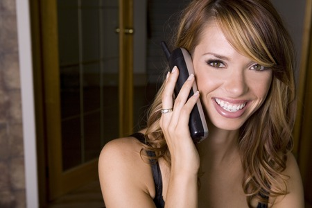 stunning woman on the phone in the office photo