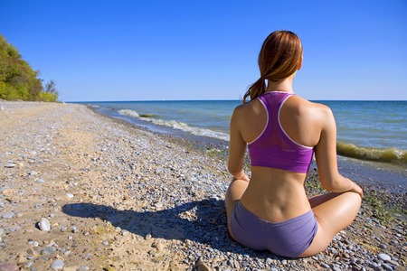sexy woman sitting on the beach relaxing in the summer Stock Photo - 1622424
