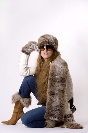stunning woman wearing winter outfit with fur and glasses Stock Photo - 1989113