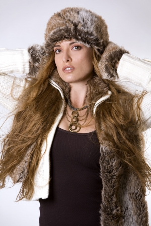 stunning woman wearing winter outfit with fur and glasses Stock Photo - 2033335