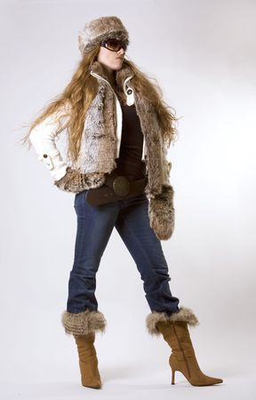 stunning woman wearing winter outfit with fur and glasses photo