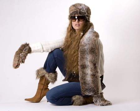 stunning woman wearing winter outfit with fur and glasses