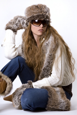 stunning woman wearing winter outfit with fur and glasses Stock Photo - 2127983