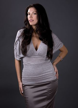 stunning woman wearing grey fashion top and skirt Stock Photo - 2127913