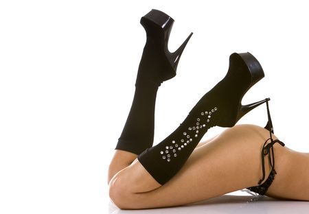 pretty legs wearing black boots on white isolated background