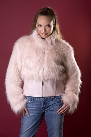 pretty model wearing pink fur coat and blue jeans Stock Photo - 2586929