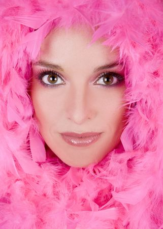 pretty model with bright makeup wearing pink boa Stock Photo