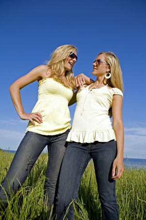 sisters wearing yellow top and jeans in the summer Stock Photo - 3187721