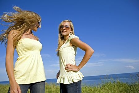 sisters wearing yellow top and jeans in the summer Stock Photo - 3187716