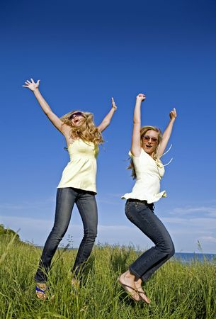 sisters wearing yellow top and jeans in the summer Stock Photo - 3187717