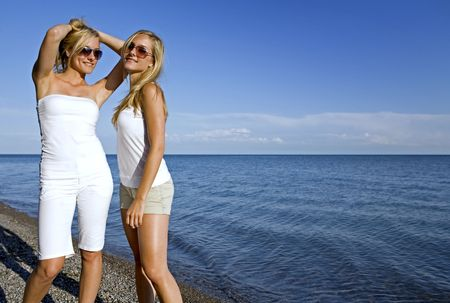 sisters wearing yellow top and jeans in the summer Stock Photo - 3187712