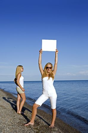 sisters holding white sign in the summer day Stock Photo - 3187714