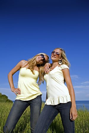 sisters wearing yellow top and jeans in the summer Stock Photo - 3208897
