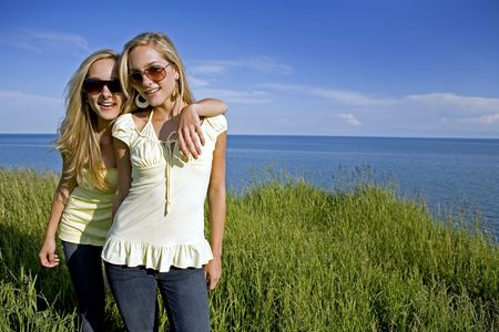 sisters wearing yellow top and jeans in the summer Stock Photo - 3208901