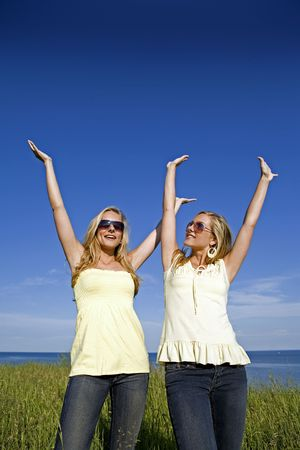 sisters wearing yellow top and jeans in the summer Stock Photo - 3208887