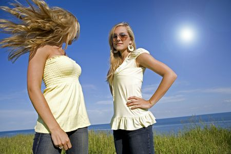 sisters wearing yellow top and jeans in the summer Stock Photo - 3305186